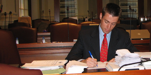 Photo of Bryan at Legislative Desk